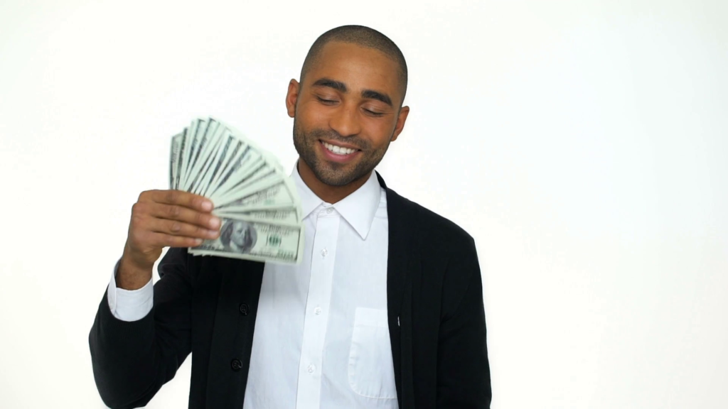 confident-african-business-man-in-formalwear-holding-money-and-waving-while-standing-against-white-background_sie-vfo1pe_thumbnail-full01